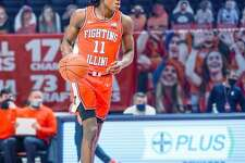 Illinois guard Ayo Dosunmu (11) controls the ball against Penn State in his team's most recent outing.