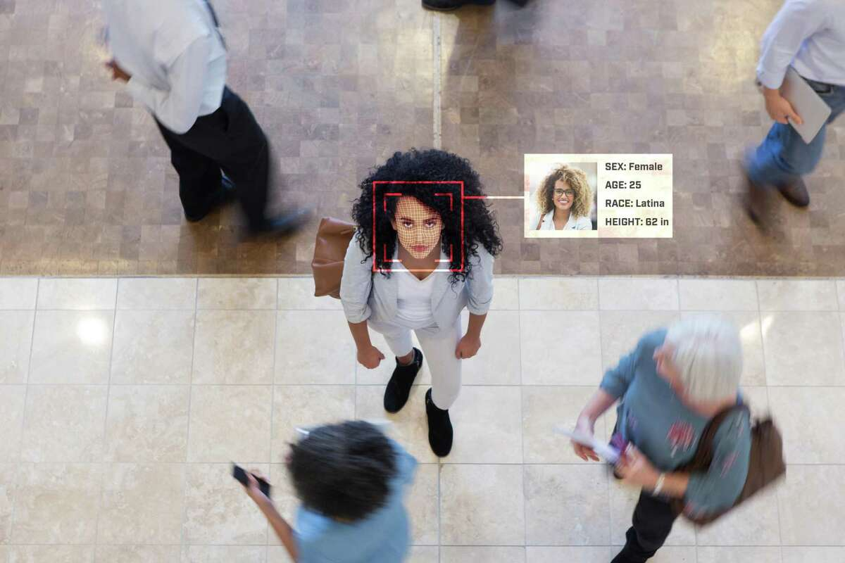 A woman stands in a lobby while a facial recognition scan describes her as a Latina, one of the pan-ethnic identifiers most used among women of Hispanic or Latino heritages, as opposed to Latinx, which is only accepted by 2 to 3% of these multicultural population.