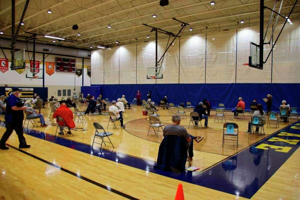 Residents who received COVID-19 vaccinations wait for 15 minutes after getting them at the mass clinic at Bad Axe High School. Ann Hepfer, the Huron County Health Officer, said that future mass clinics would be at the Assembly of God church in Bad Axe. (Tribune File Photo)