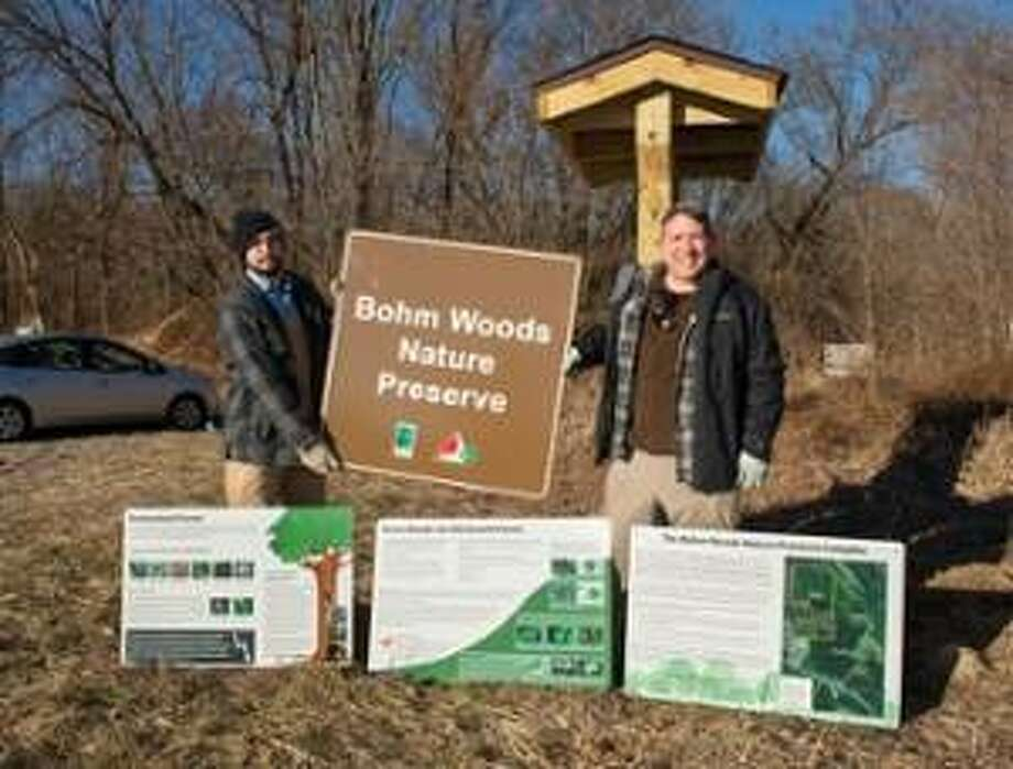 Noah Dell, of Friends of Bohm Woods, and SIUE Biological Sciences professor Rick Essner show signage for Bohm Woods funded by the Meridian Society.