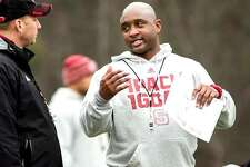 George McDonald, right, during his six-year stint as an assistant coach at NC State. McDonald, a former Illini player, was recently hired to be the new Illinois receivers coach.