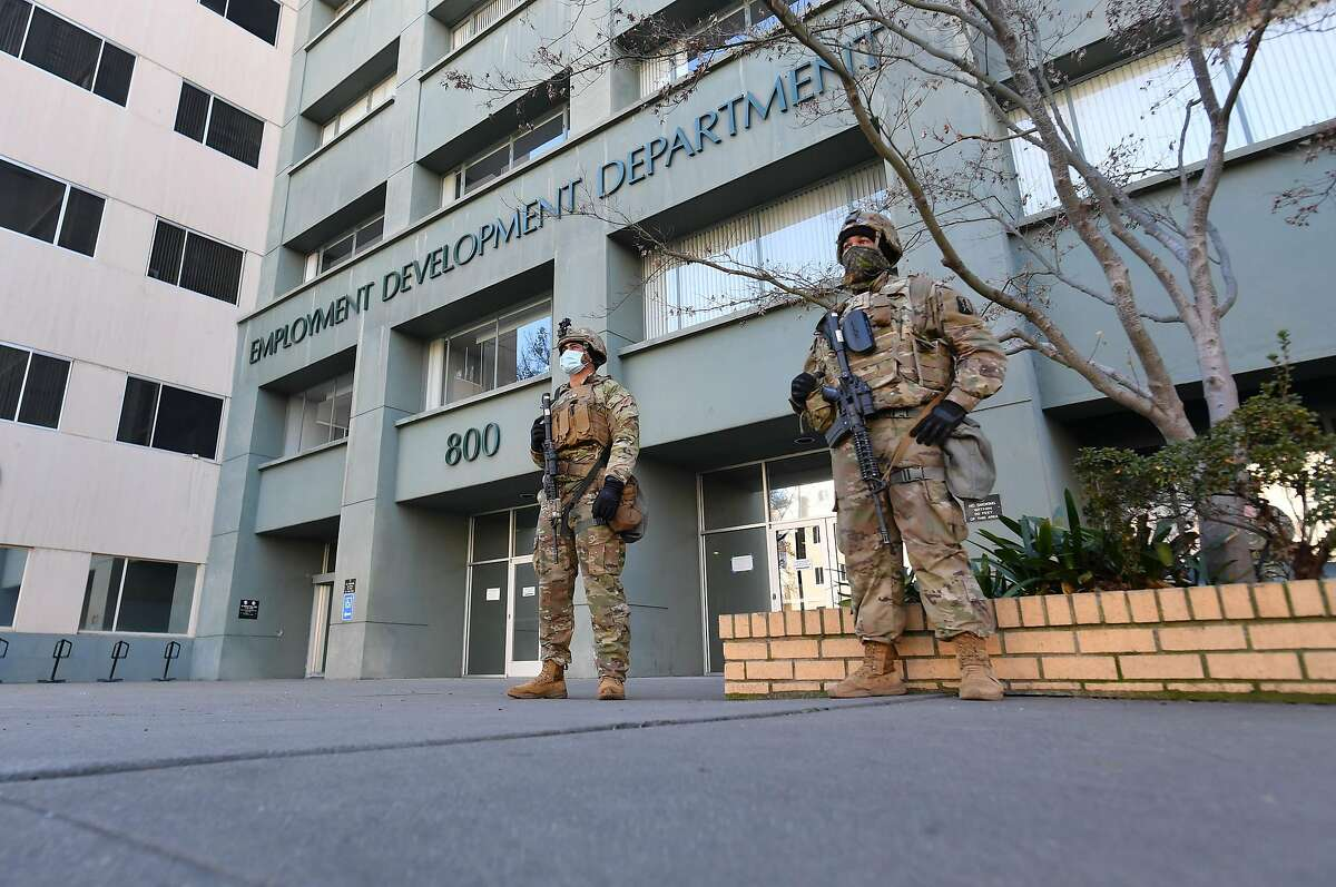 National Guard members were posted outside the Employment Development Department headquarters in Sacramento this month amid threats of anti-government violence.