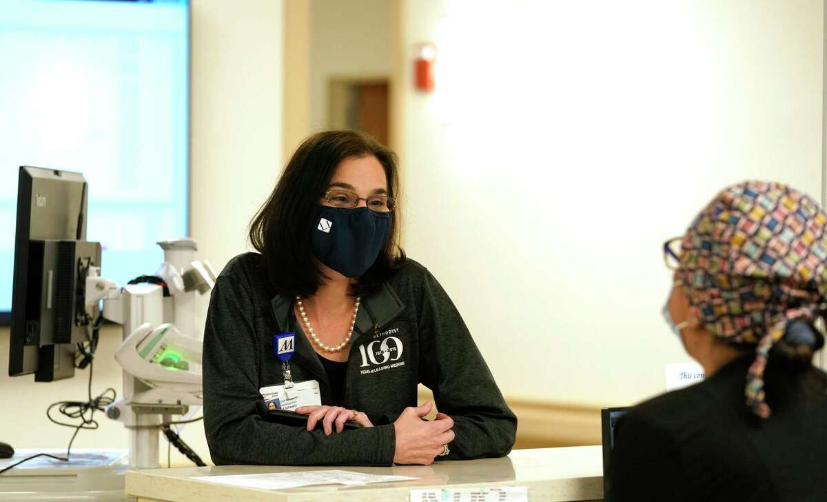 Roberta Schwartz, Houston Methodist Hospital CEO, left, talks with Memoona Ladha, RN, in the hospital's transplant unit, Tuesday, Jan. 19, 2021 in Houston.