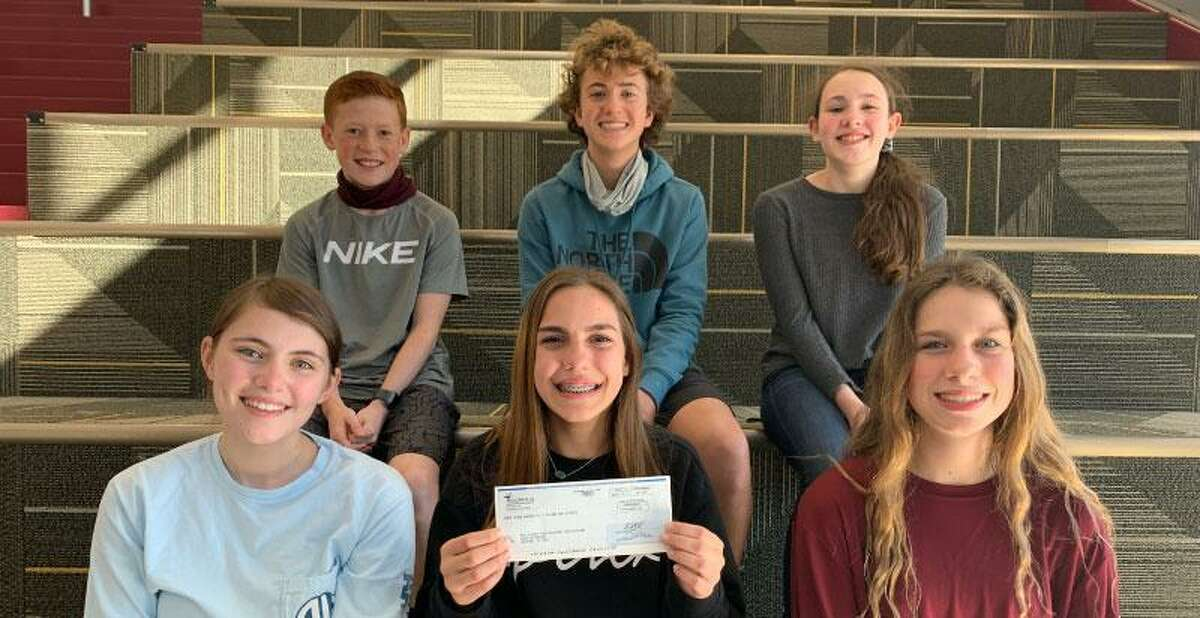 Magnolia Intermediate School Lone Star Leadership students Ramsey Anzick, Zane Daniel, Katelyn Fontenot, Kylie Knepprath, Luke Mattingly, and Carley Raphelt pose with the $750 raised through a two-day book sale last year, which the Lone Star Leadership group recently donated to the Make-A-Wish Foundation.
