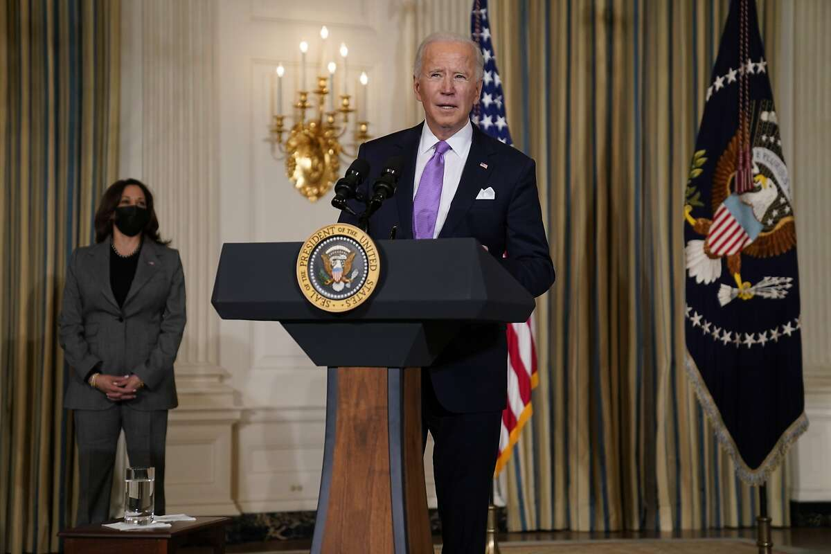 President Biden, who has made immigration reform a priority, delivers remarks on racial equity in the State Dining Room of the White House as Vice President Harris listens.