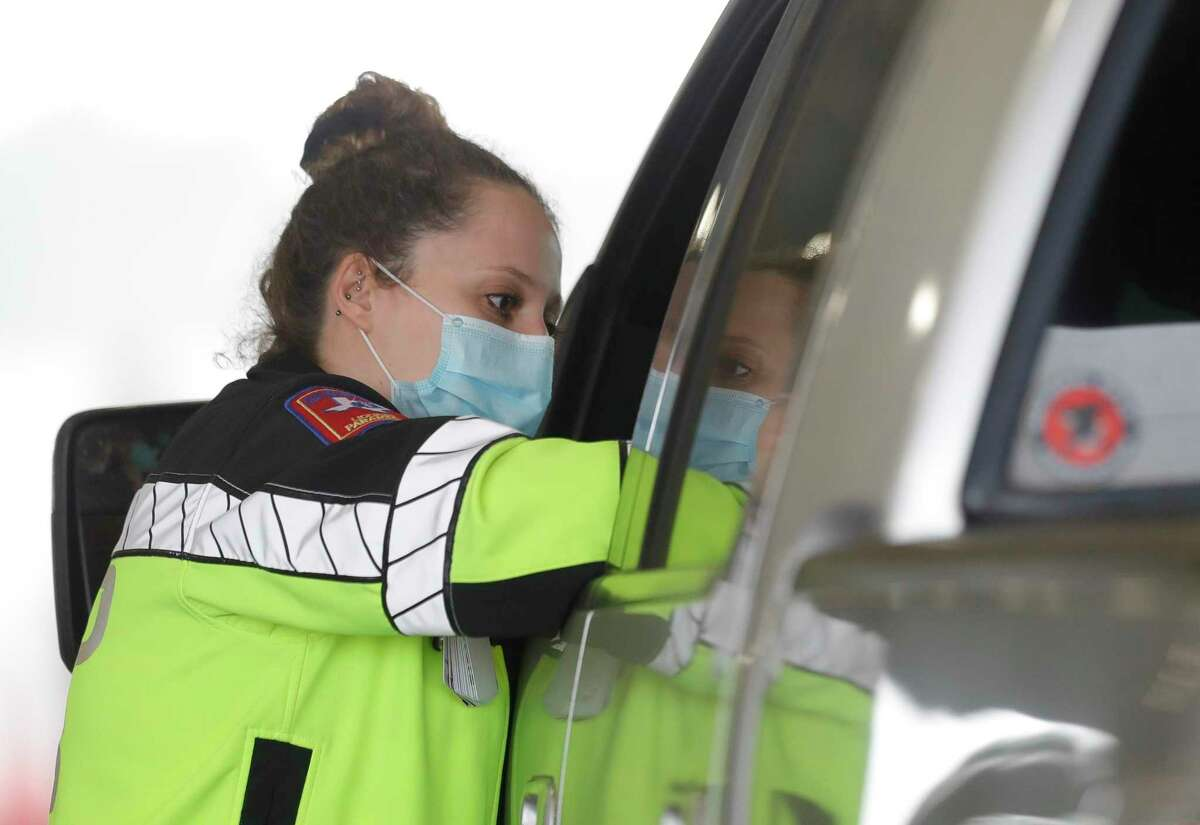 Montgomery County Hospital District paramedic Jade Campbell administers a COVID-19 vaccine to a resident at Montgomery County's first mass COVID-19 vaccination site at the Montgomery County Fairgrounds, Wednesday, Jan. 20, 2021, in Conroe.