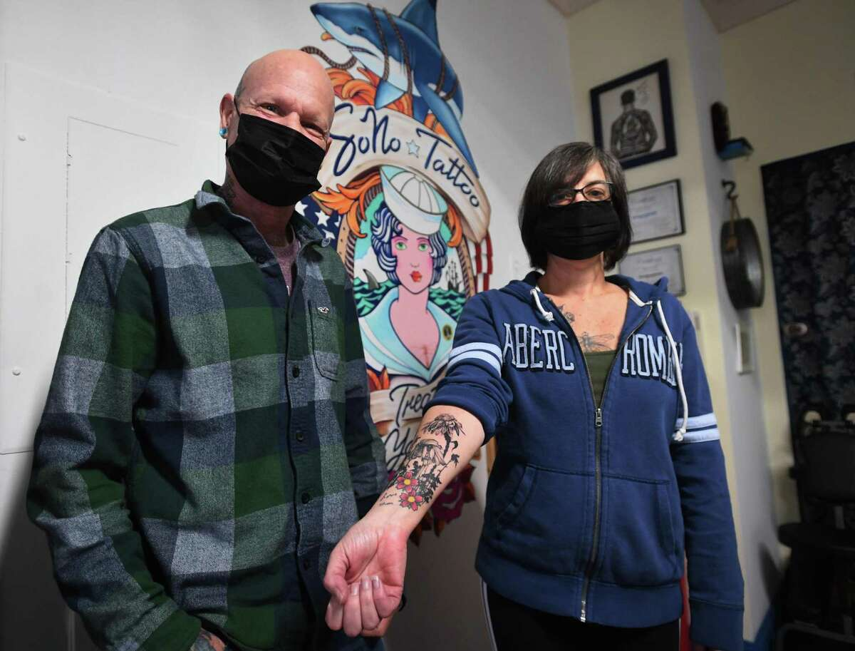 Tattoo artist Brian Sells and Paula Torelli at SoNo Tattoo at 127 Washington Street in Norwalk, Conn. on Monday, January 25, 2021. The couple have operated the shop for two months.