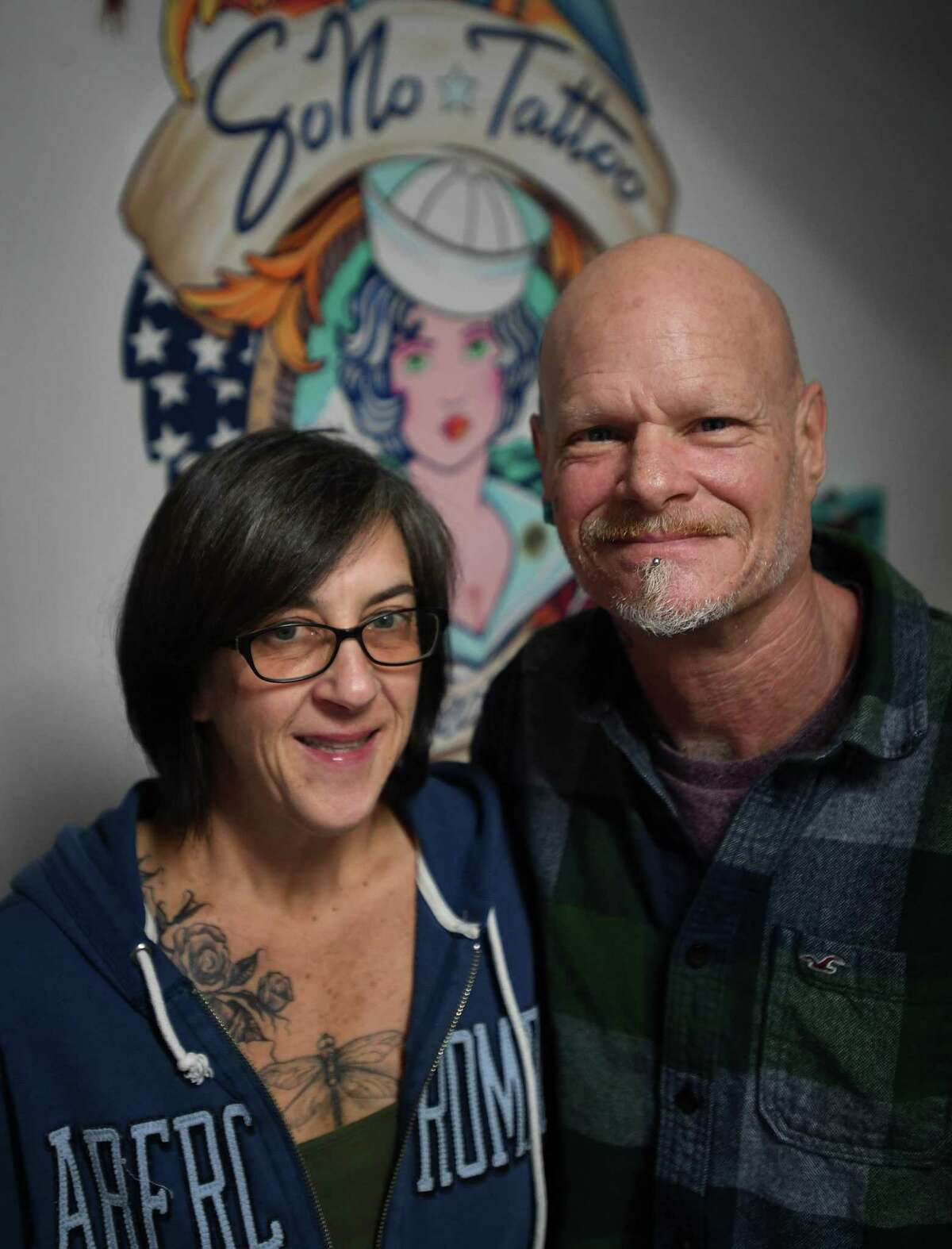 Paula Torelli and tattoo artist Brian Sells at SoNo Tattoo at 127 Washington Street in Norwalk, Conn. on Monday, January 25, 2021. The couple have operated the shop for two months. At SoNo Tattoo, Torelli handles the business side of the shop while Sells administers the tattoos. Sells is the only tattoo artist at the shop, allowing him full control over the quality of each tattoo, he said.