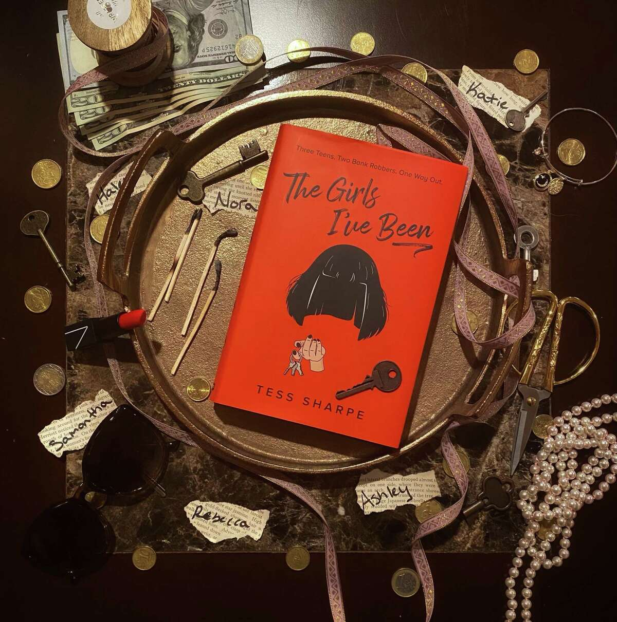 """""""The Girls I've Been"""" is a YA thriller about a former con artist by Tess Sharpe."""