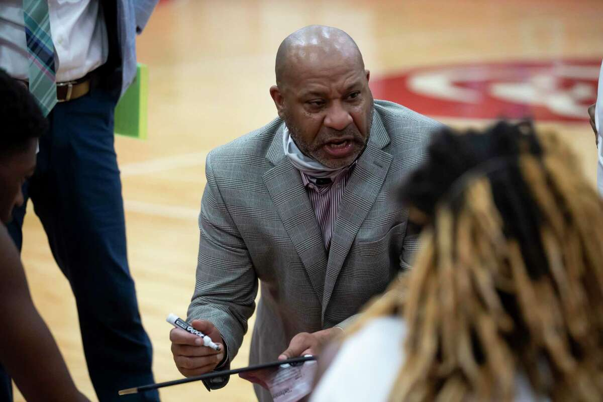 Crosby head coach Edwin Egans speaks with his team during a timeout in the fourth quarter of a District 21-5A basketball game at Crosby High School, Friday, Jan. 22, 2021, in Crosby.