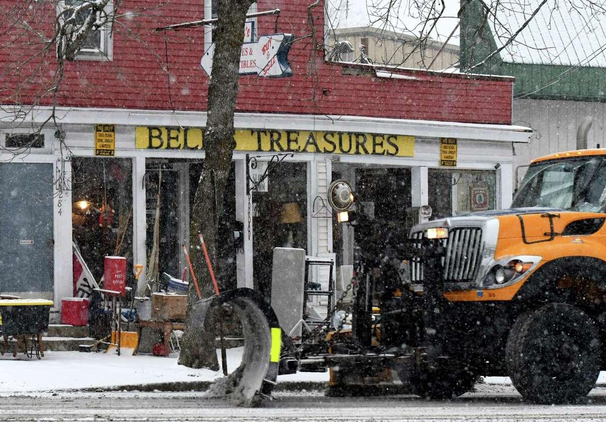 A DOT snowplow clears Milton Avenue on Tuesday, Jan. 26, 2021, in Ballston Spa, N.Y. (Will Waldron/Times Union)