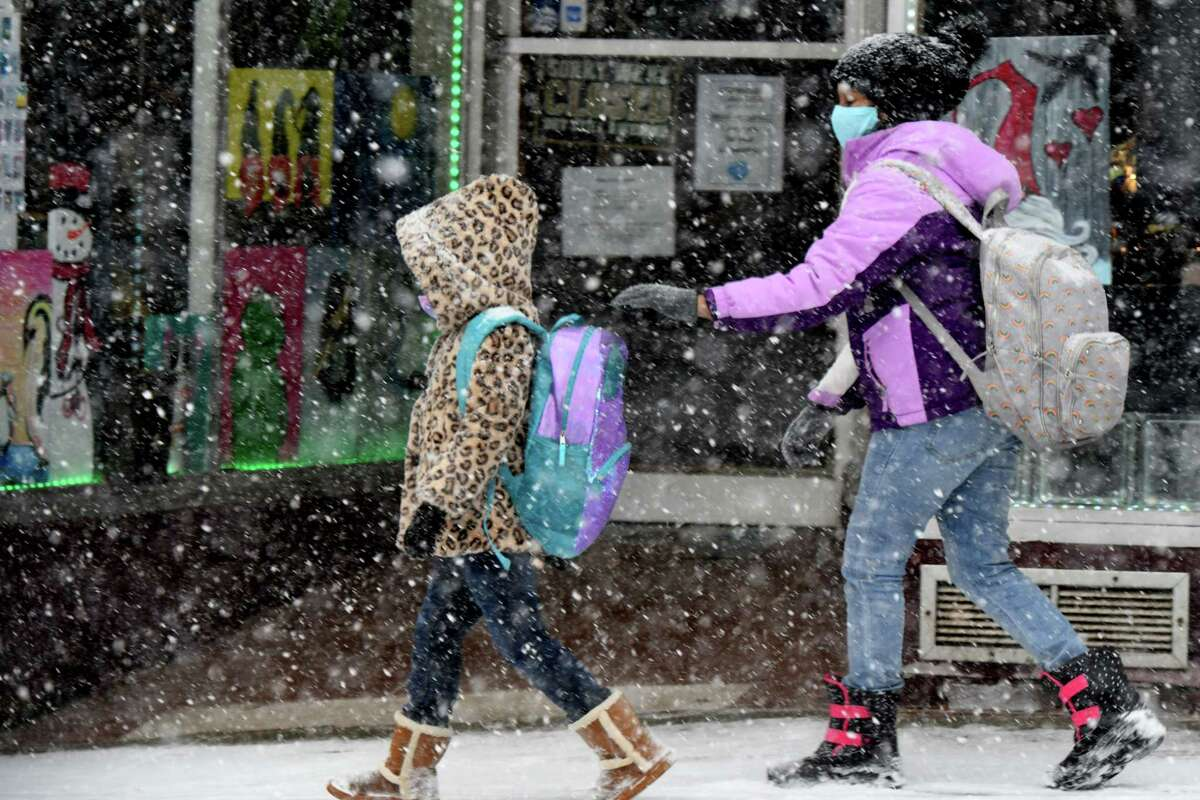 Schoolchildren navigate an afternoon snowstorm along Milton Avenue on Tuesday, Jan. 26, 2021, in Ballston Spa, N.Y. (Will Waldron/Times Union)