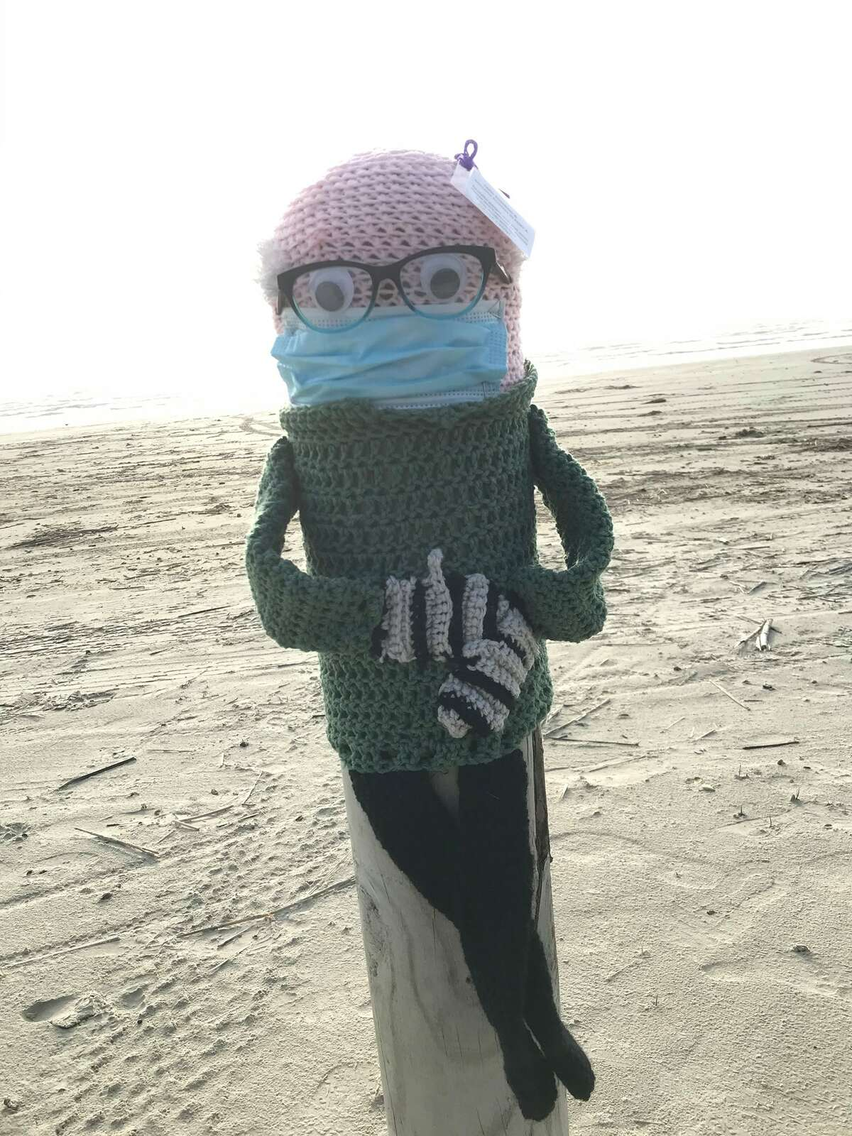 You can now find the meme of Vermont Senator Bernie Sanders and his viral hand-knit mittens crocheted on a bollard, vertical posts used to control traffic and mark boundaries, at Port Aransas beach.