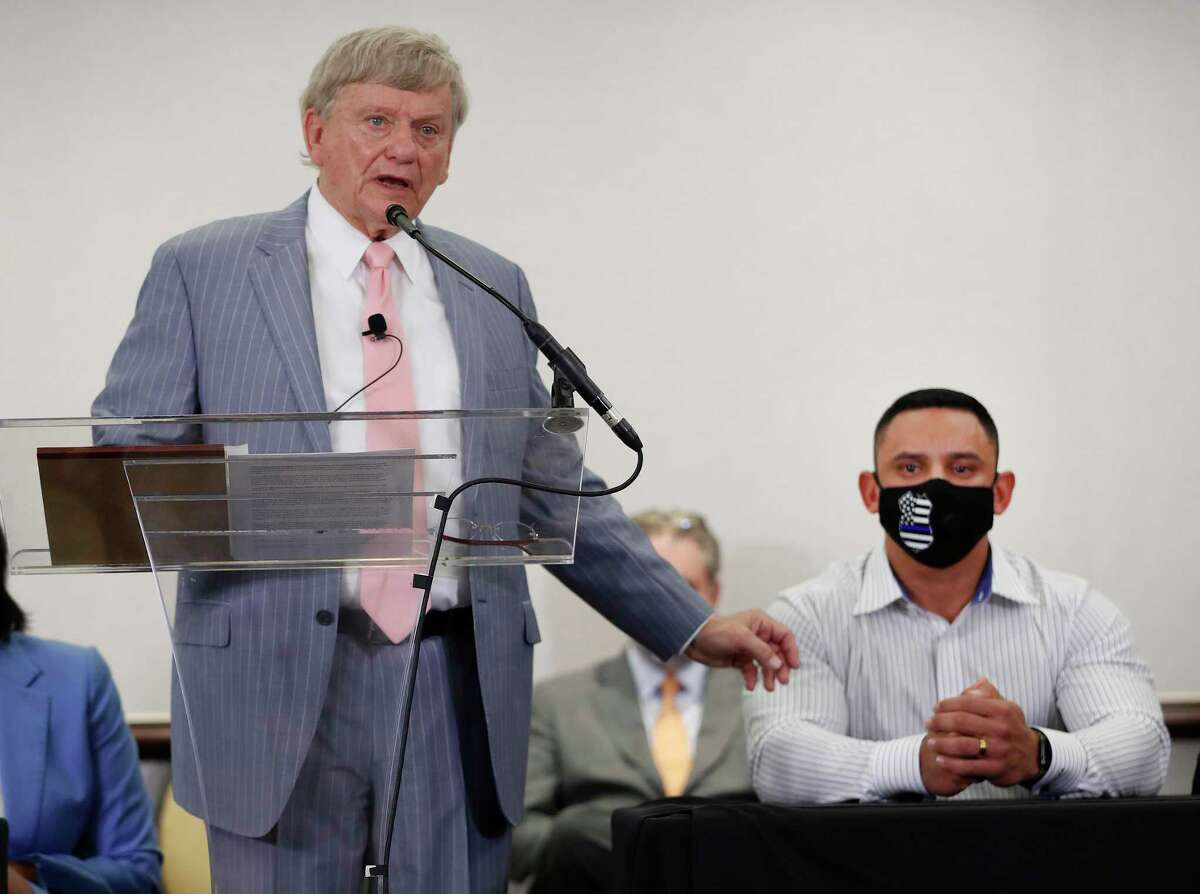 Rusty Hardin speaks during a press conference at Hilton Americas, in Houston, Tuesday, Jan. 26, 2021, to discuss the indictment handed down to Houston Police officer Felipe Gallegos, right, for his actions in the Harding Street case.