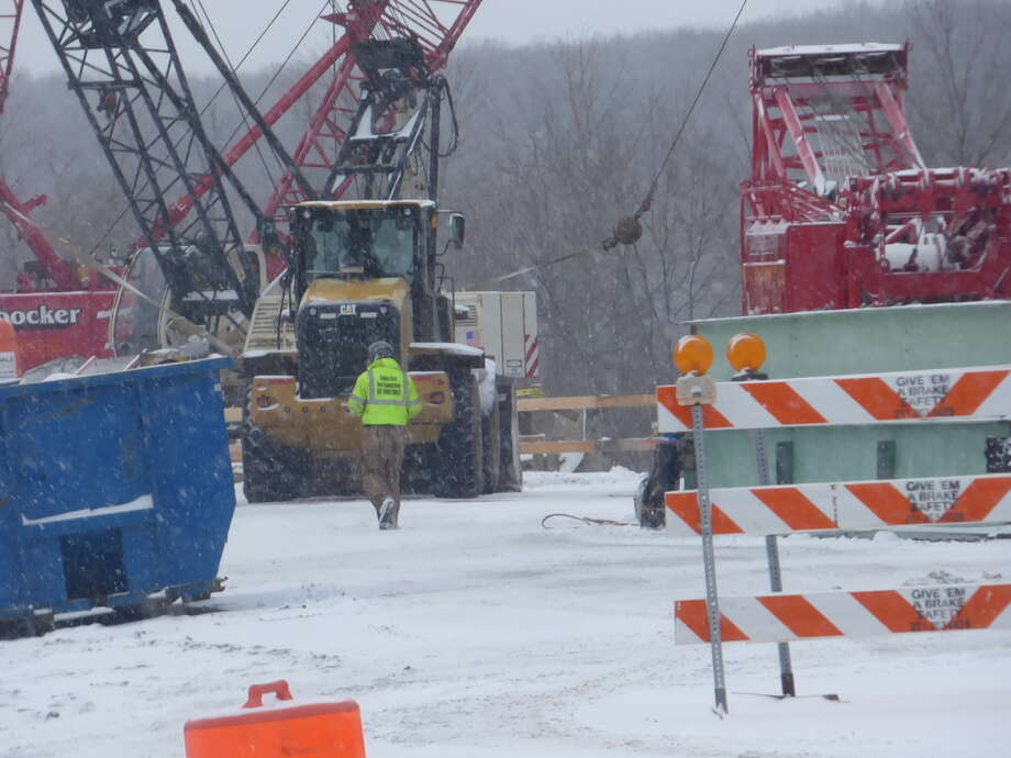 Work on the M-55 bridge in Manistee despite snow flurries leading to several inches of accumulation on Tuesday Photo: Scott Fraley/News Advocate