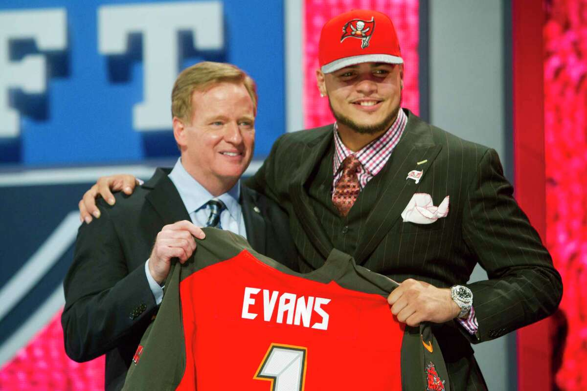 Texas A&M's Mike Evans poses for photos with NFL Commissioner Roger Goodell after being selected by the Tampa Bay Buccaneers during the NFL Draft at Radio City Music Hall Thursday, May 8, 2014, in New York. ( Brett Coomer / Houston Chronicle )