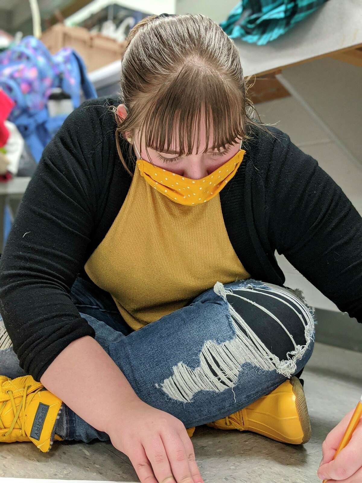 Emma Mondrella, a Big Rapids High School student and technician for the production, gets to work designing costumes. There will be approximately 50 costumes throughout the course of the production. (Courtesy photo)