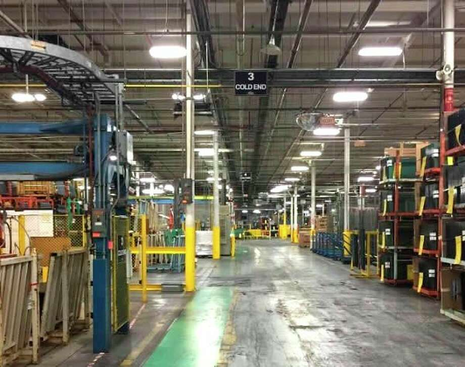 This file photo shows the inside of a Vitro factory building. The Evart location closed its doors last year and now a material handling company is preparing to bring a new industry to the city. (File photo)