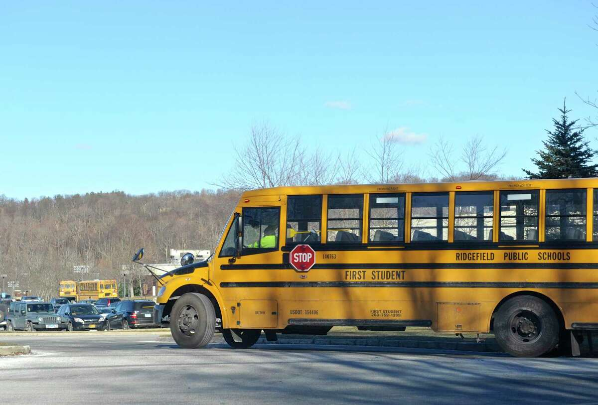 A school bus heads towards Ridgefield High School on Thursday afternoon at the end of the school day. January 21, 2016, in Ridgefield, Conn.
