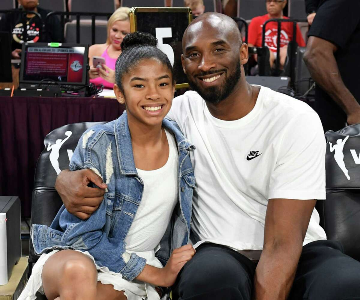 Gianna Bryant and her father, former NBA star Kobe Bryant, attend the 2019 WNBA All-Star Game in Las Vegas.