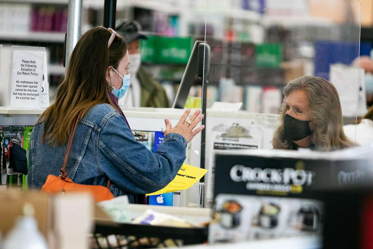Tief Gibbs of Novato talks with a clerk at Bed Bath and Beyond about why she was not buying products. The protest has to do with BB&B taking My Pillow products off of shelves in Larkspur, Calif. on January 26th, 2021