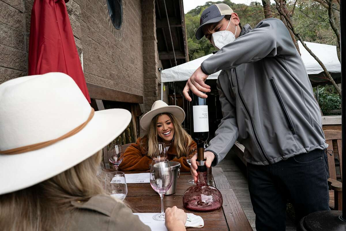 Erika Altes and Andrea Lowry wine taste at the Matanzas Creek Winery in Santa Rosa. Wineries have reopened outdoors after Gov. Newsom lifted California's strict lockdown.