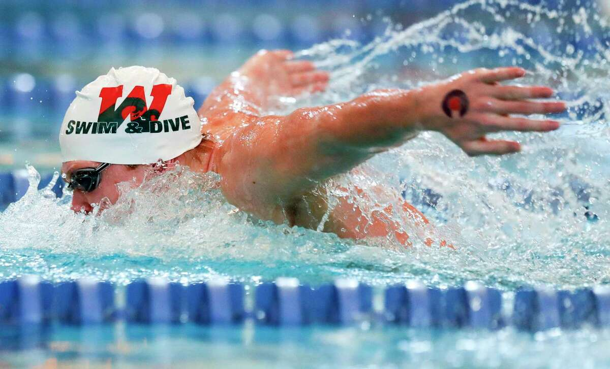 Tyler Hulet of The Woodlands competes in the boys 100-yard butterfly during the District 13-6A swimming meet at the Conroe ISD Natatorium, Saturday, Jan. 23, 2021, in Shenandoah.