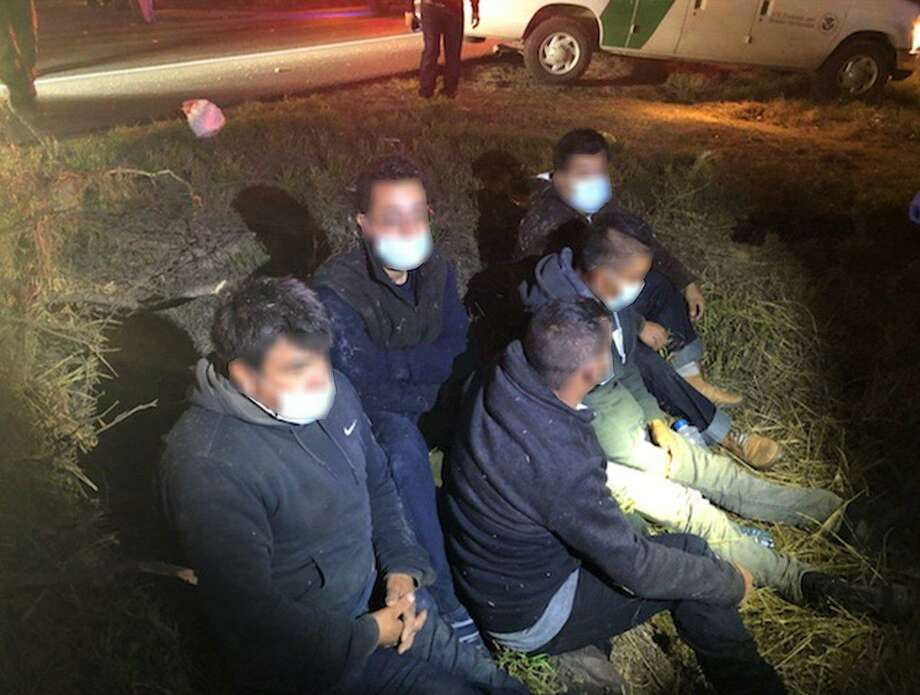 U.S. Border Patrol agents rendered aid to this group of people following a rollover crash near the bowling alley in Zapata County. Agents determined that the individuals were immigrants who had crossed the border illegally. Photo: Courtesy Photo /U.S. Border Patrol