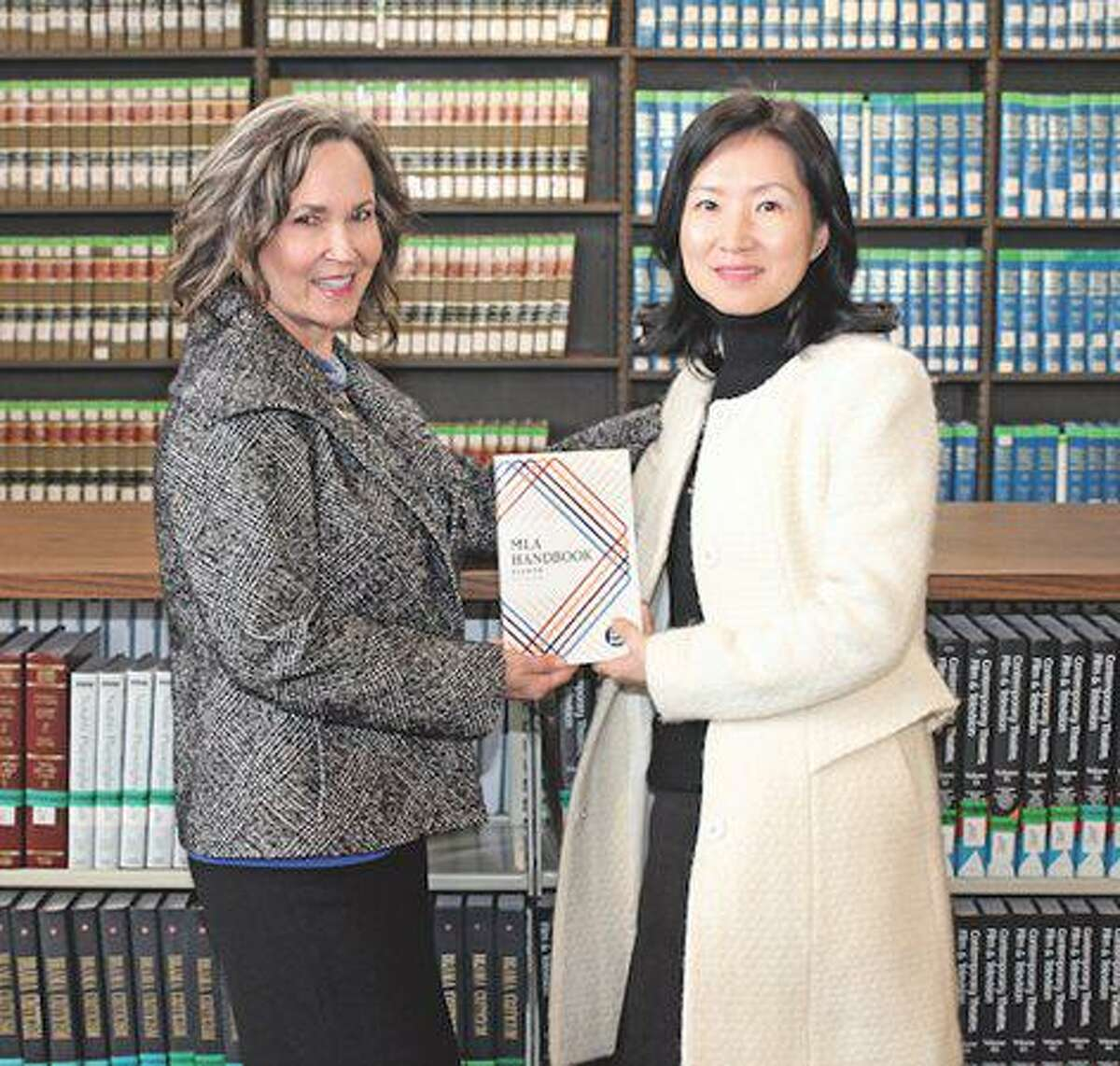 Michelle Judice and Yumi Shin of Lamar State College Port Arthur were \ honored by the Texas Library Association in March for their study on the positive impact of library instruction on College English students. Shin recently had a study published in a national journal.