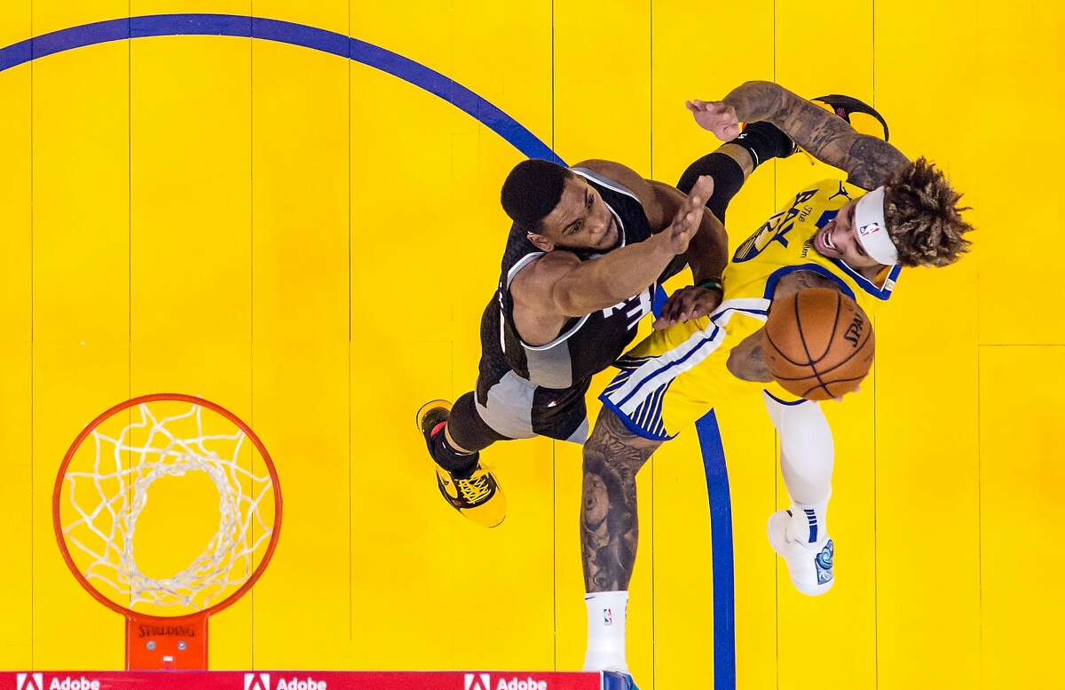 Kelly Oubre Jr. (12) puts up a shot in the first half as the Golden State Warriors played the Sacramento Kings at Chase Center in San Francisco, Calif., on Monday, January 4, 2021.