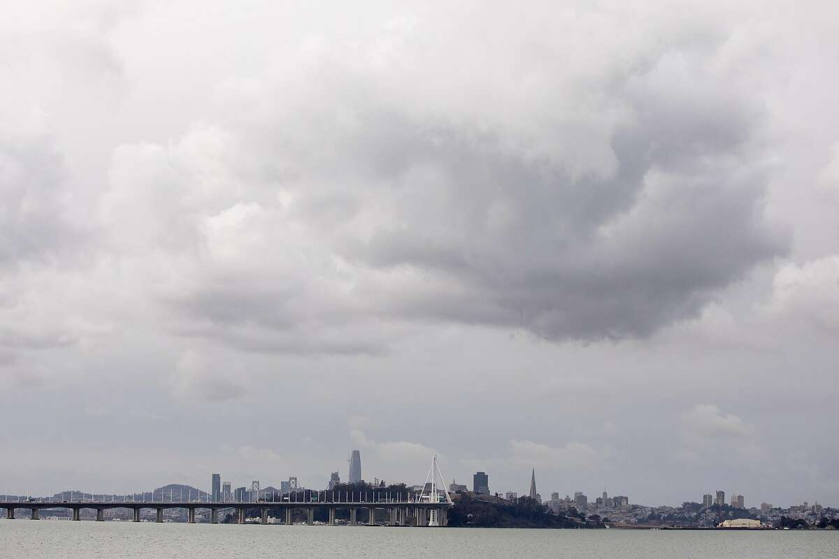 Dark clouds gather in the skies above the San Francisco Bay as a storm moves into the region, seen from Emeryville Marina in Emeryville, Calif. Tuesday, January 26, 2021.