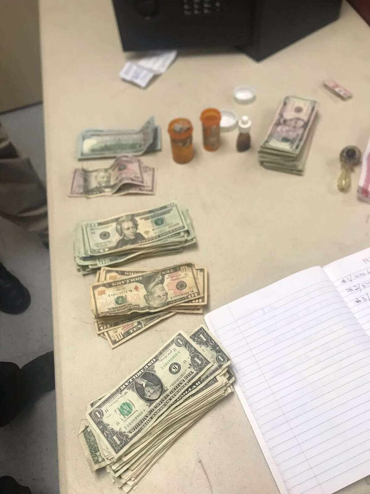The Zapata County Sheriff's Office seized cash, marijuana, heroin and liquid heroin known as