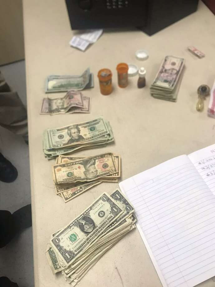 "The Zapata County Sheriff's Office seized cash, marijuana, heroin and liquid heroin known as ""agua de chango."" Photo: Courtesy Photo /Zapata County Sheriff's Office"