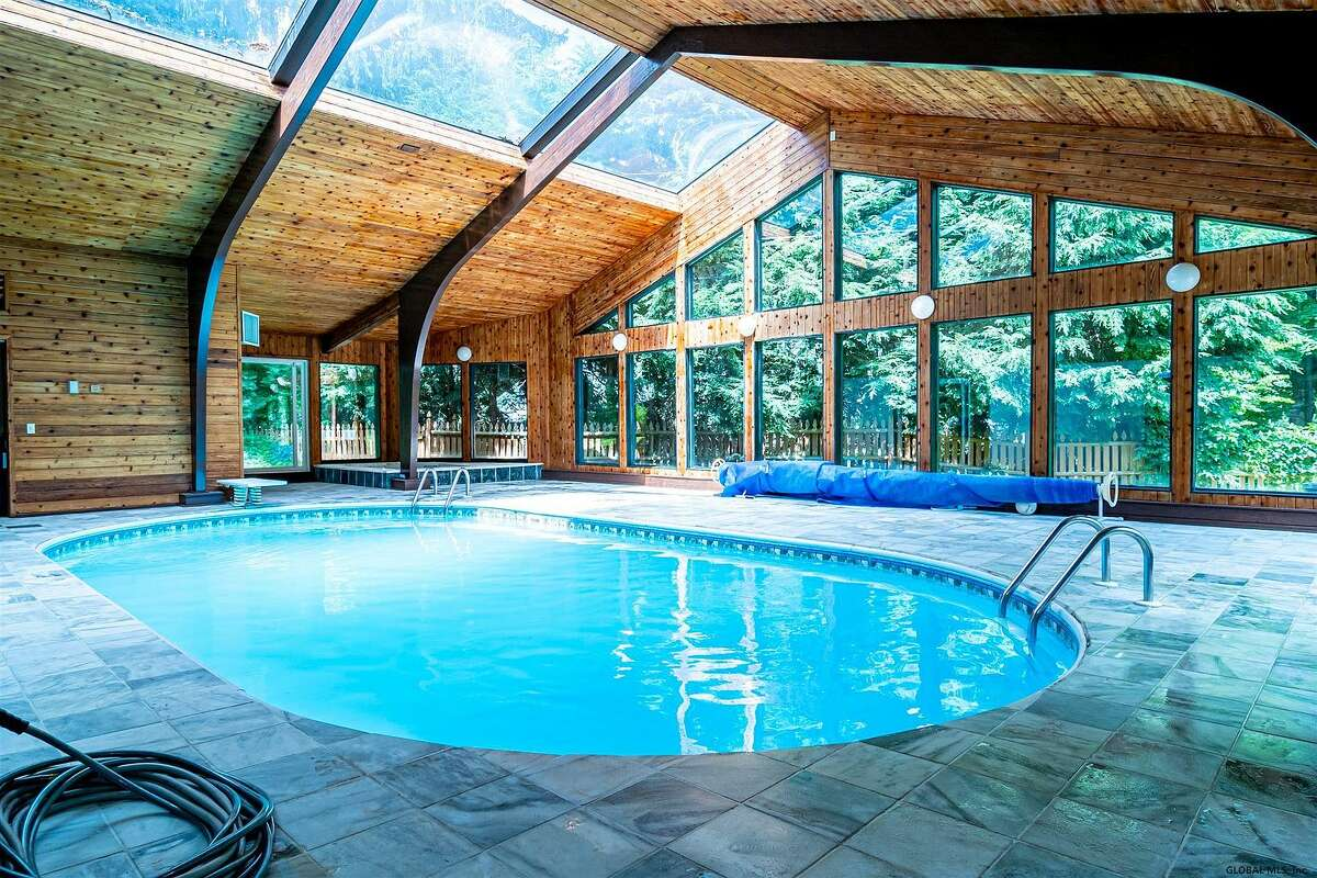 Scroll through the photos below to take a peek inside four homes currently for sale in the Capital Region, each featuring a spectacular indoor swimming pool.