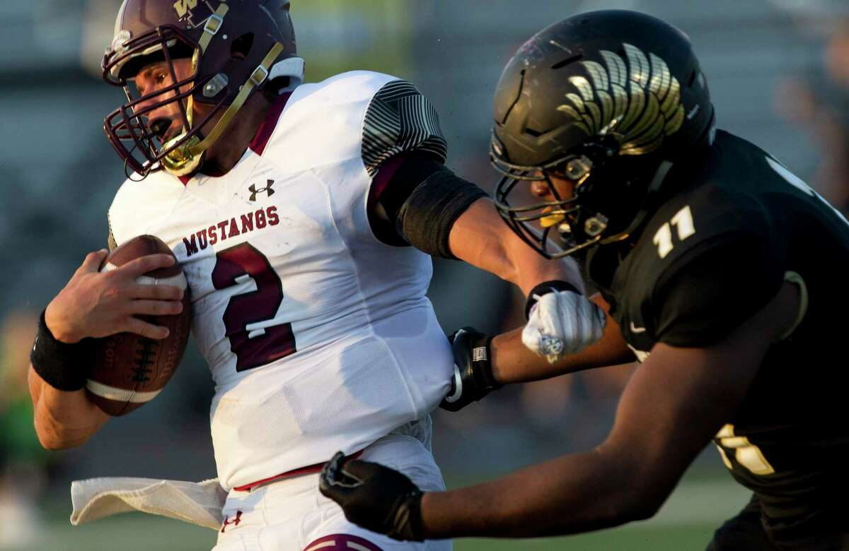 Magnolia West quarterback Tristan Brady (2) is sacked by Foster defensive tackle Tyler Onyedim (11) during the second quarter of a non-district high school football game at Guy K. Traylor Stadium, Saturday, Sept. 14, 2019, in Rosenberg.