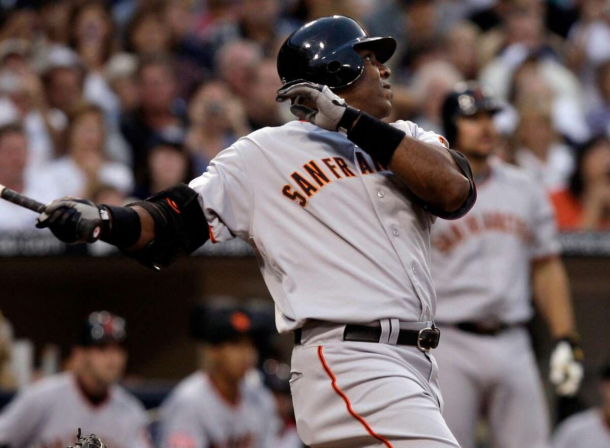 San Francisco Giants' Barry Bonds watches the flight of his home run, his 755th, during the second inning of their Major League Baseball game against the San Diego Padres in San Diego, Saturday, Aug. 4, 2007. With the hit, Bonds caught Hank Aaron and tied the career home run record. (AP Photo/ Kevork Djansezian)