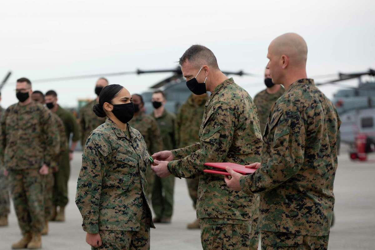 Lance Cpl. Alyssa David receives the Navy and Marine Corps Commendation Medal for heroic service during a ceremony at Marine Corps Air Station New River, North Carolina, January 22, 2021. (U.S. Marine Corps photo by Lance Cpl. Yuritzy Gomez)