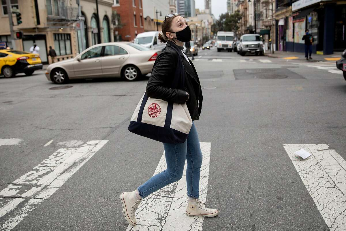 Becca Camping walks up Hyde Street as she makes her way to Trader Joe's in San Francisco. She had her unemployment benefits account frozen like many other Californians; while she was able to get her account restored, she's still waiting for some benefits.