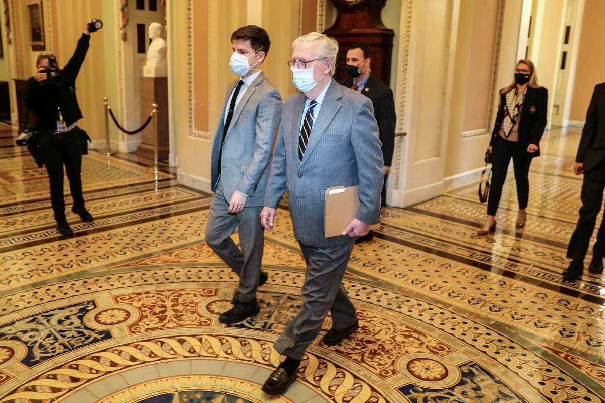 Senate Minority Leader Mitch McConnell (R-Ky.) walks to the Senate chamber at the Capitol in Washington on Tuesday, Jan. 26, 2021. McConnell on Monday dropped his demand that the new Democratic Senate majority promise to preserve the filibuster - which Republicans could use to obstruct President Biden's agenda - ending an impasse that had prevented Democrats from assuming full power even after their election wins. (Oliver Contreras/The New York Times)
