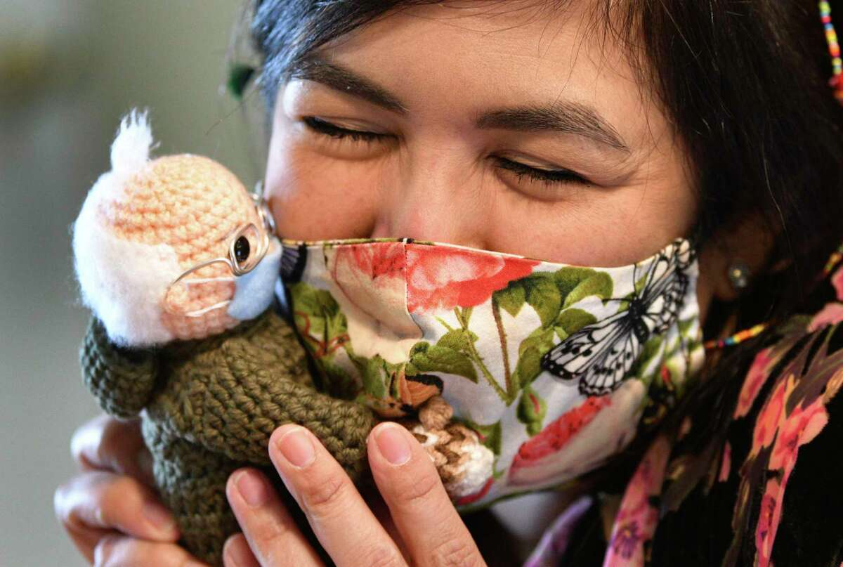 Tobey King, of Corpus Christi, embraces the crochet Bernie Sanders doll that she made and sold on eBay for $20,300 Tuesday. All of the proceeds are being donated to Meals on Wheels America.