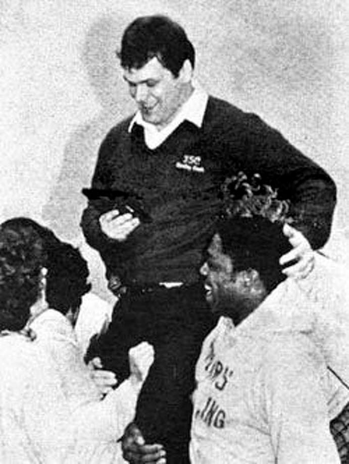 Former Ferris State wrestling coach Dan Ley celebrates a special moment with his team in the early 1980s. (Courtesy photo)