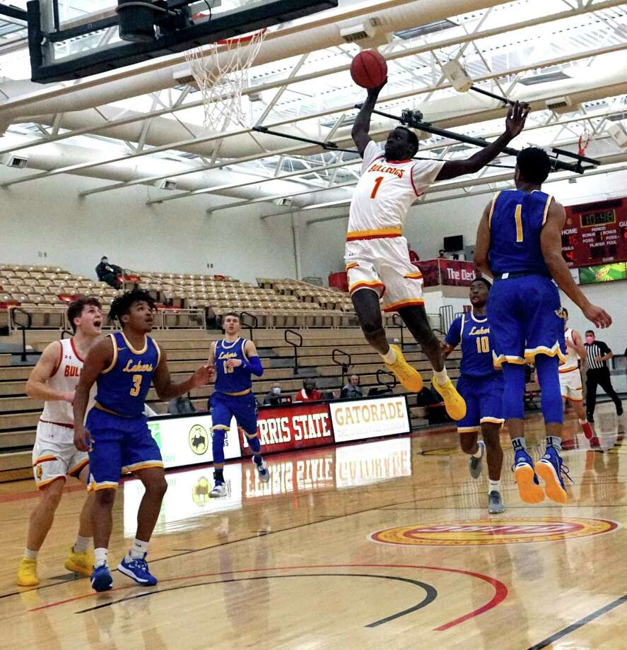 Ferris State sophomore Deng Reng glides through the air en route to a slam dunk during the Bulldogs' defeat against Lake Superior State Tuesday night at Wink Arena. (Pioneer photo/Joe Judd)