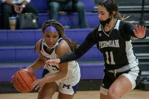 Midland High's Mia Mitchell tries to drive around Permian's Camila Leal 01/26/2021 at the Midland High gym. Tim Fischer/Reporter-Telegram