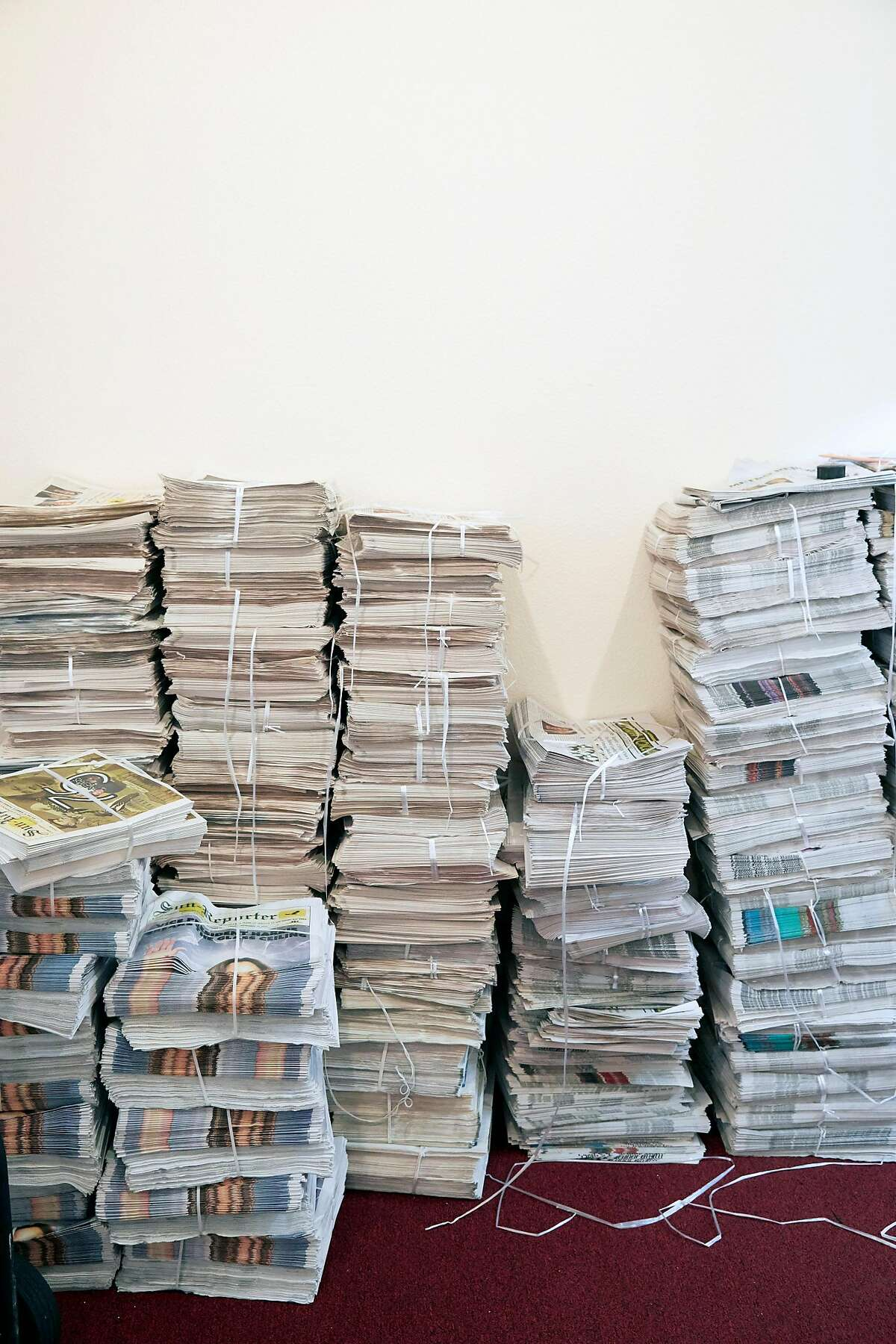 Stacks of the Sun-Reporter, San Francisco's oldest Black newspaper. It was founded in 1944 and has published weekly ever since. Readers can find the newspapaer at Bay Area newsstands and inside local Black churches and businesses, or have it delivered to their homes.