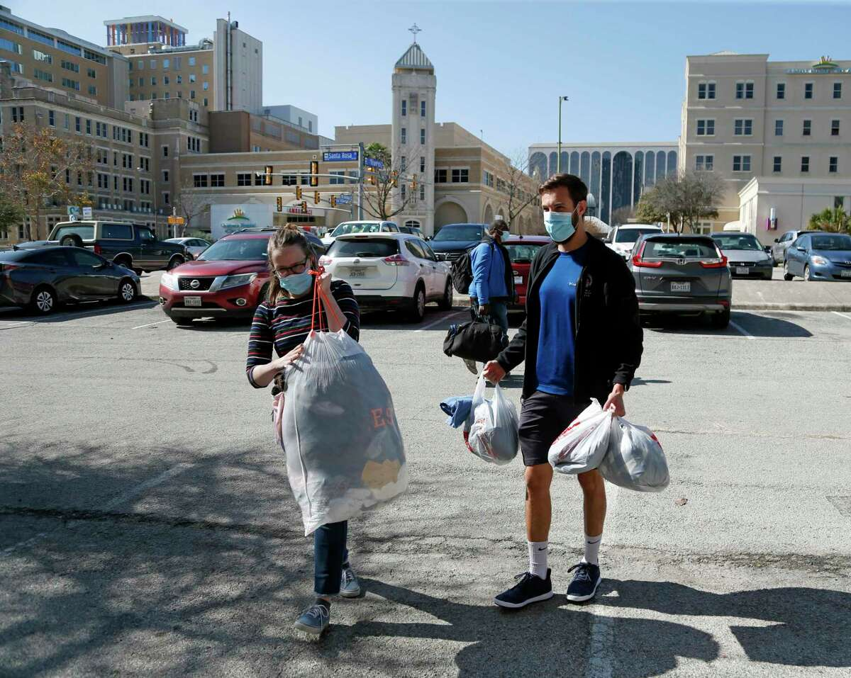 Alyssa Gooch helps Kaleb Starr unload his donations. Because of COVID, the South Alamo Regional Alliance for the Homeless has cancelled its 2021 unsheltered point-in-time count. Instead, the organization is hosting a street outreach day of appreciation on TuesdayJan. 26, 2021