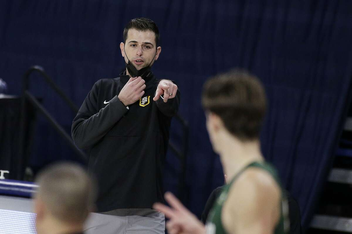 San Francisco head coach Todd Golden directs his team during the second half of an NCAA college basketball game against Gonzaga in Spokane, Wash., Saturday, Jan. 2, 2021. (AP Photo/Young Kwak)