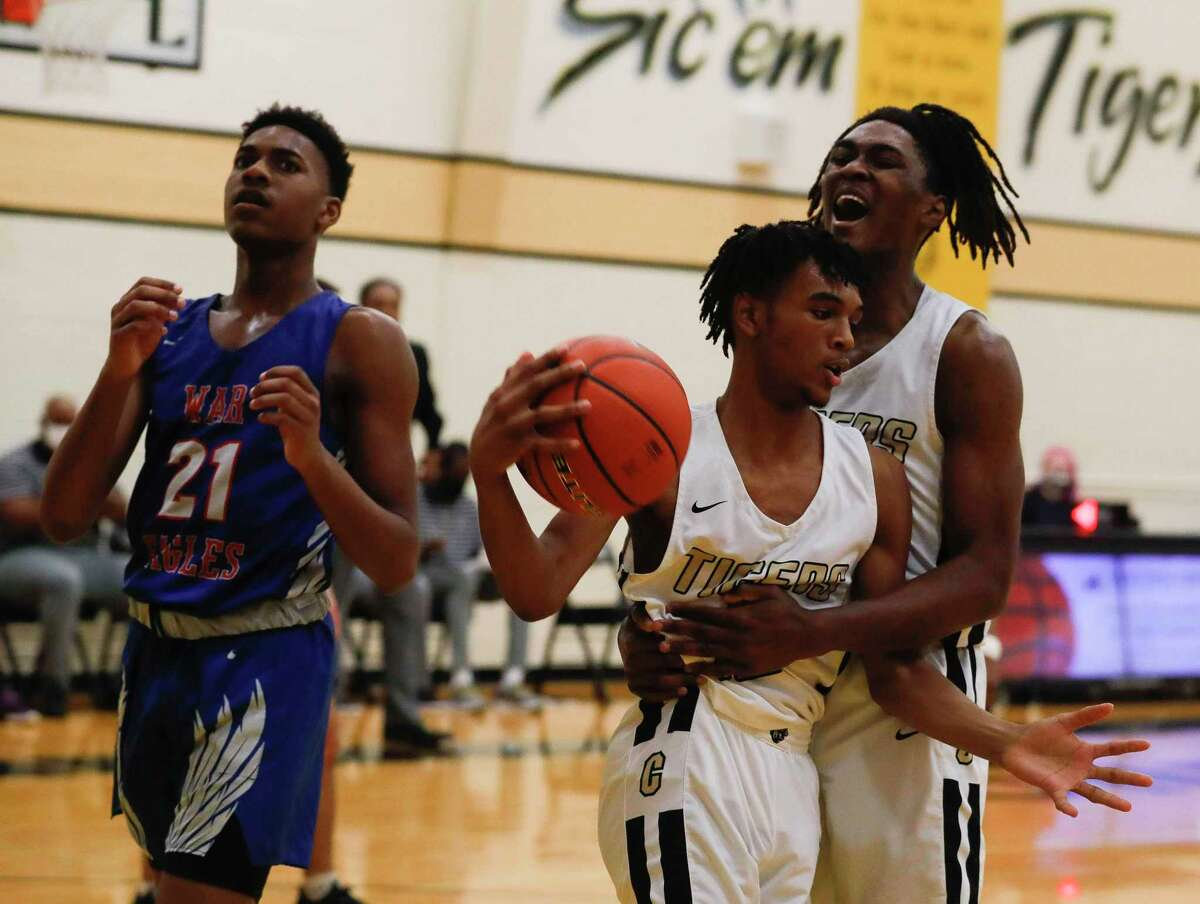 Conroe's Ja'Len Moore (0) yells in celebration after Nigel Leday drew a foul by Oak Ridge's Bryce Bass (21) during the fourth quarter of a District 15-6A high school basketball game at Conroe High School, Tuesday, Jan. 26, 2021, in Conroe.