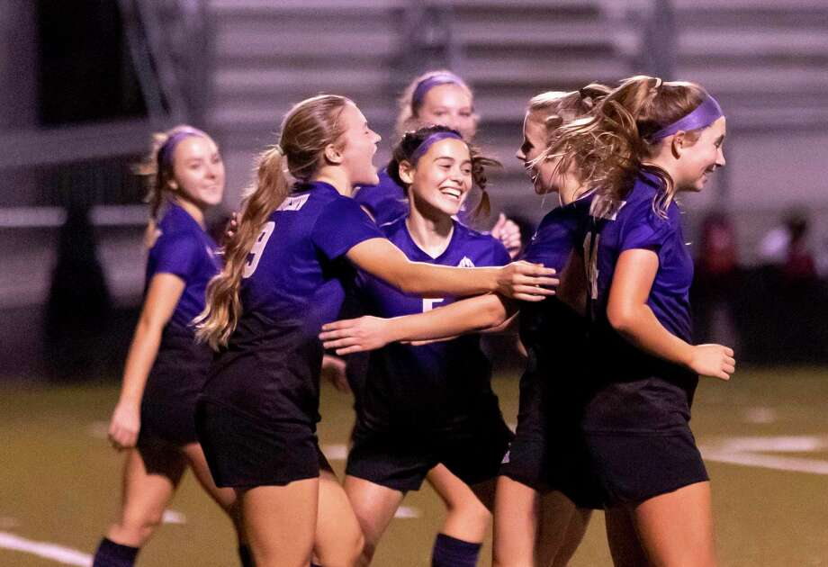 Montgomery soccer girls react after they score during the first period of a District 20-5A girls high school soccer match against Caney Creek at Montgomery High School, Tuesday, Jan. 26, 2021, in Montgomery. Photo: Gustavo Huerta, Houston Chronicle / Staff Photographer / Houston Chronicle © 2021