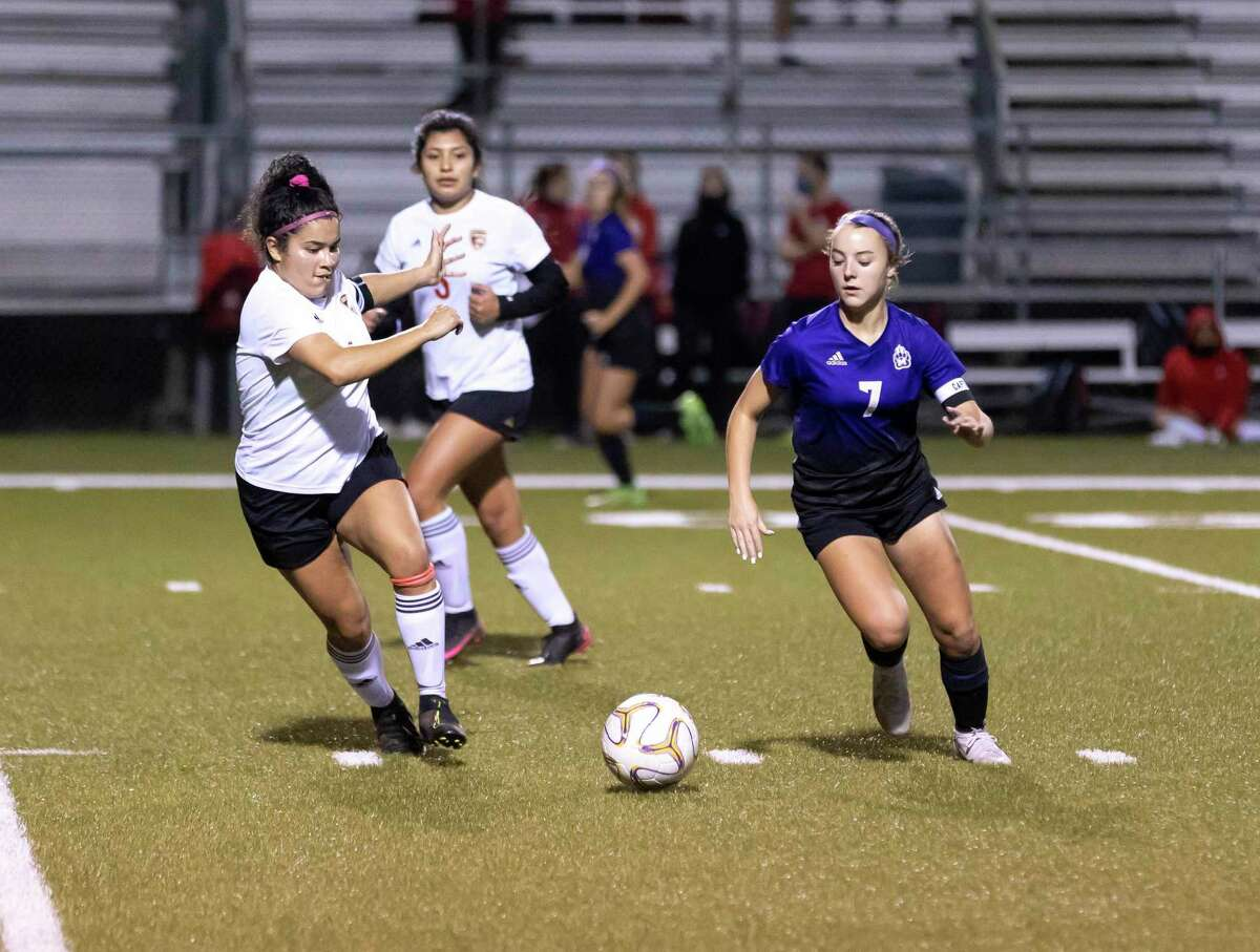 Caney Creek Brandy Amaya (4) and Montgomery defensive midfielder Makenzie Griffith (7) rush to grab a loose ball during the first period of a District 20-5A girls high school soccer match at Montgomery High School, Tuesday, Jan. 26, 2021, in Montgomery.