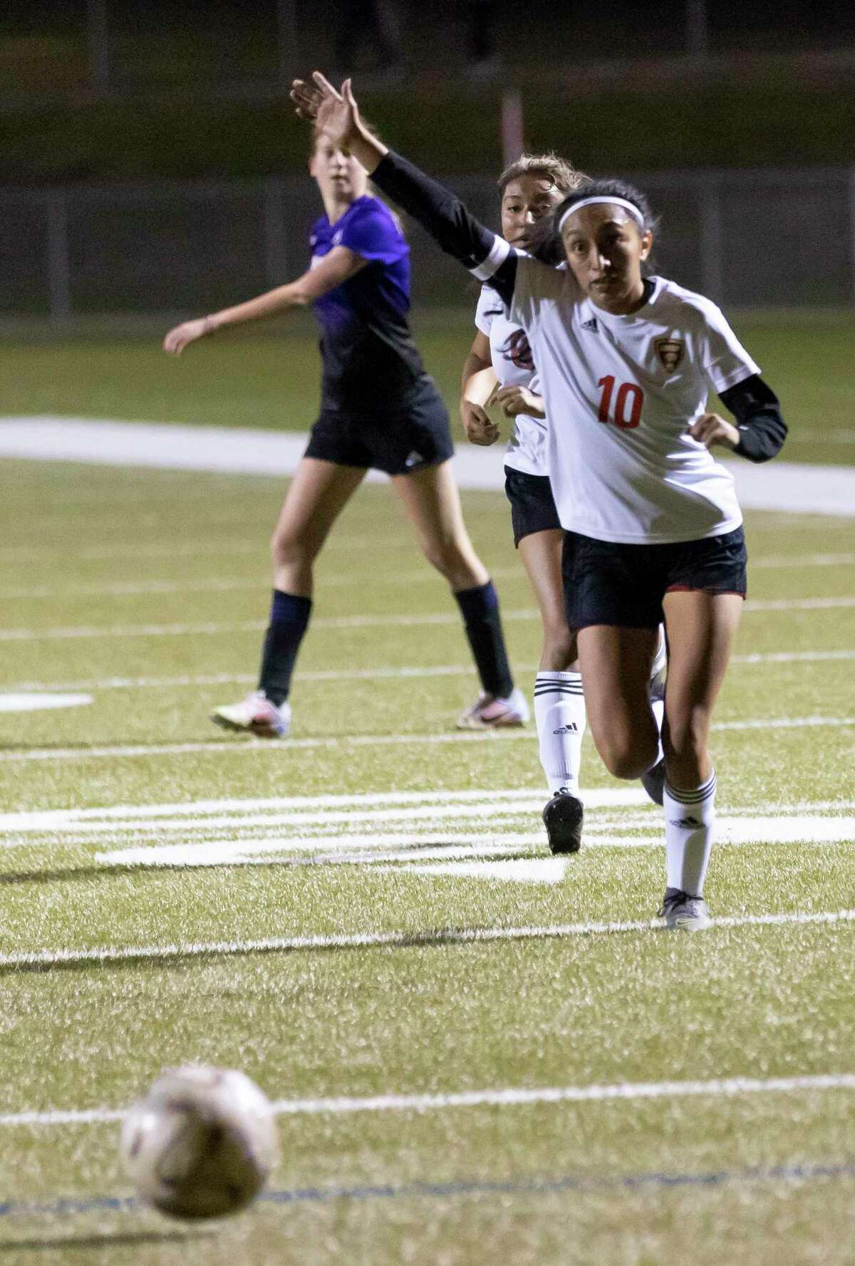Caney Creek Julie Mendoza (10) calls for the goal keeper to grab a loose ball during the first period of a District 20-5A girls high school soccer match against Montgomery at Montgomery High School, Tuesday, Jan. 26, 2021, in Montgomery.
